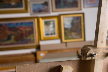 Part of painter's easel in a gallery
