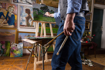 Male painter in the process of painting