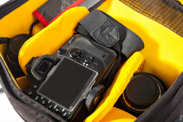 black with yellow camera bag to open the camera lens.