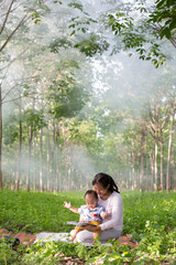 asia mother reading book for her baby