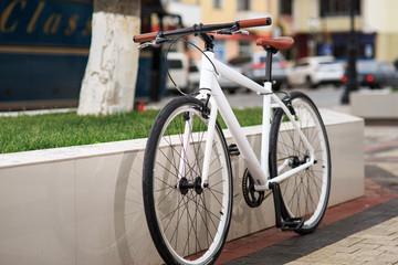 white fixed-gear bicycle on street