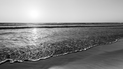 Impressive seascape of Ocean Beach in San Diego, California. Sunset. Black and white