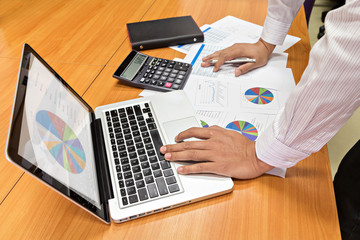 Business man working at office with laptop and documents