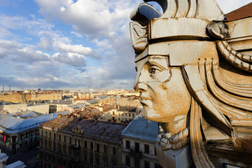 Head above the roofs of buildings of St. Petersburg.