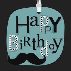 Abstract close up of hanging Happy Birthday message tag with mustache