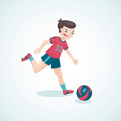 Kick the ball.Young boy is playing soccer.