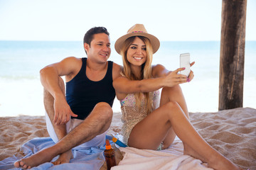 Couple at the beach taking a selfie