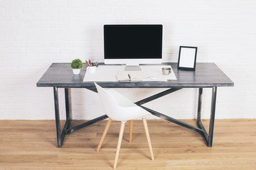 Desk with frames and monitor