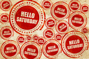 hello saturday, red stamp on a grunge paper texture