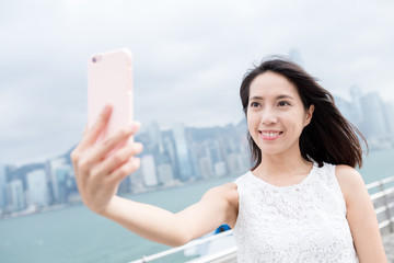 Woman take selfie at Hong Kong city