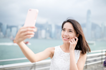 Woman taking self image by mobile phone