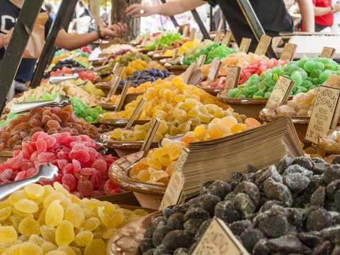 Traditional sweets (gominolas artesanas) made out of dried fruit with sugar for sale on a market stand at Majorca,Spain, Europe - overview