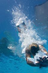 Wall Mural - Diver entering water, underwater shot