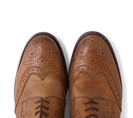 Mens brown leather brogues isolated on a white background