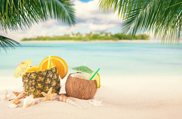 Sandy tropical beach with summer drinks