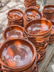 Traditional pottery for cooking made out of clay for sale on a market stand at Majorca,Spain, Europe - close-up
