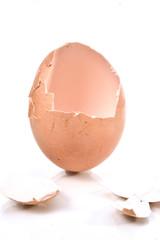 a cracked eggshell, broken eggshell on white background