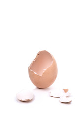 a cracked eggshell, broken eggshell on white background