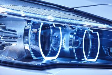 Car light detail in blue tone Vehicle part. Vertical