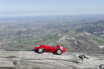 Model of old car and breathtaking landscape