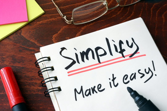 Notepad with sign simplify.  Make it easy.