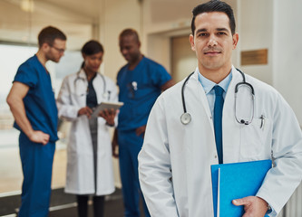 Confident young Hispanic doctor