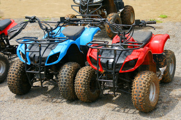 Red and blue ATV quad bike in Thailand