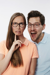 Silly couple pulling faces in studio