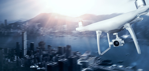 Photo White Matte Generic Design Remote Control Air Drone with action camera Flying Sky under City. Modern Megapolis Sunset Background. Wide, front side view. Motion Blur Effect. 3D rendering.