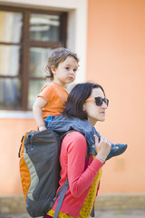 Mom is traveling with the child.