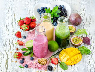 Berry and fruits smoothie in bottles, healthy summer detox drink