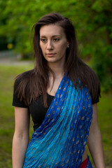 Pretty brunette woman wearing  indian dress and scarf