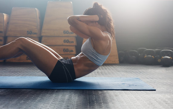 Fitness woman doing abs crunches