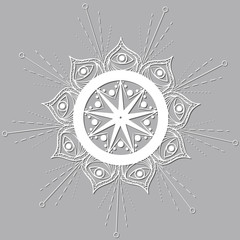 Hand-drawn white mandala with a star and the eye of the Buddha with the shadow on a gray background