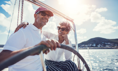 Smiling mature couple on yacht