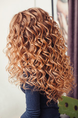 close-up of curly blond hair in barber beauty salon