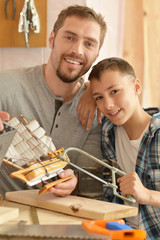 father and son with toy ship