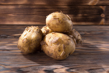young potatoes on the wooden background