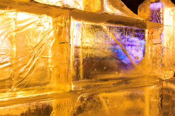 Ice sculptures with yellow and purple light highlights