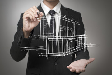 Businessman drawing a model of the house