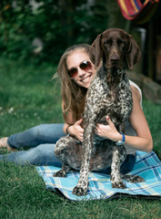 beautiful young woman with her dog outdoor