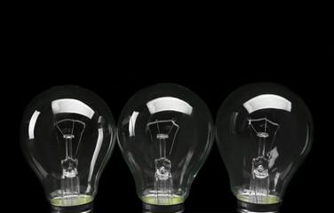 Electric bulbs on dark grey background