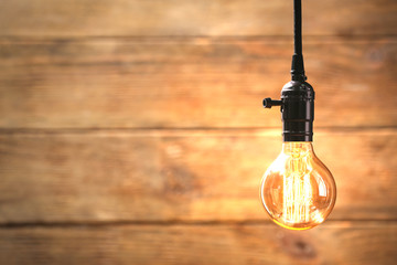 Bright bulb on wooden background