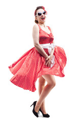 Beautiful young woman with pin-up make-up and hairstyle posing o