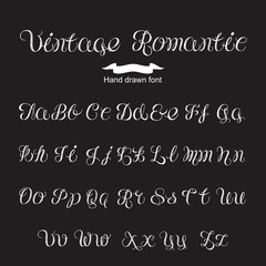Hand written calligraphy vintage romantic font. White letters