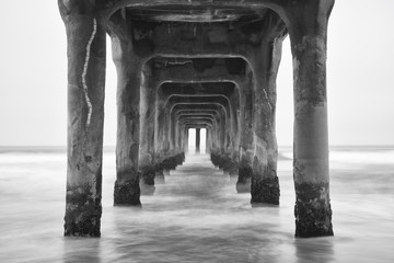 Under the Pier. Black and white photo Manhattan Beach, Californi