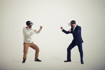 Two men in virtual reality glasses on white background