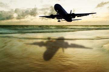 Dark airplane with blurred seascape