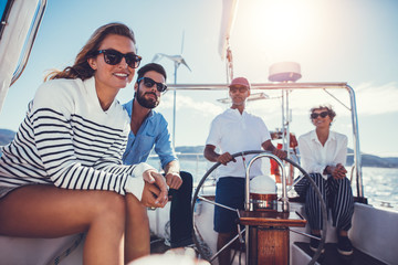 Two couples on yacht on sunny day