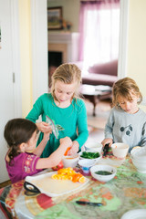 Three young girls preparing food
